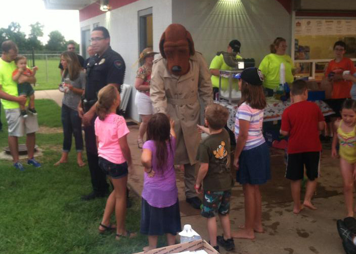 National Night Out McGruff the Crime Fighting Dog with children